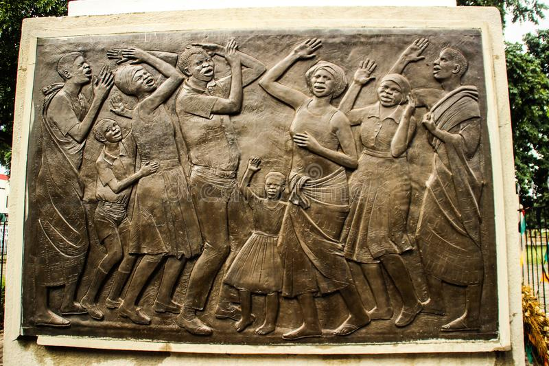 bas-relief element of the monument of independence depicting women in the city center stock photography