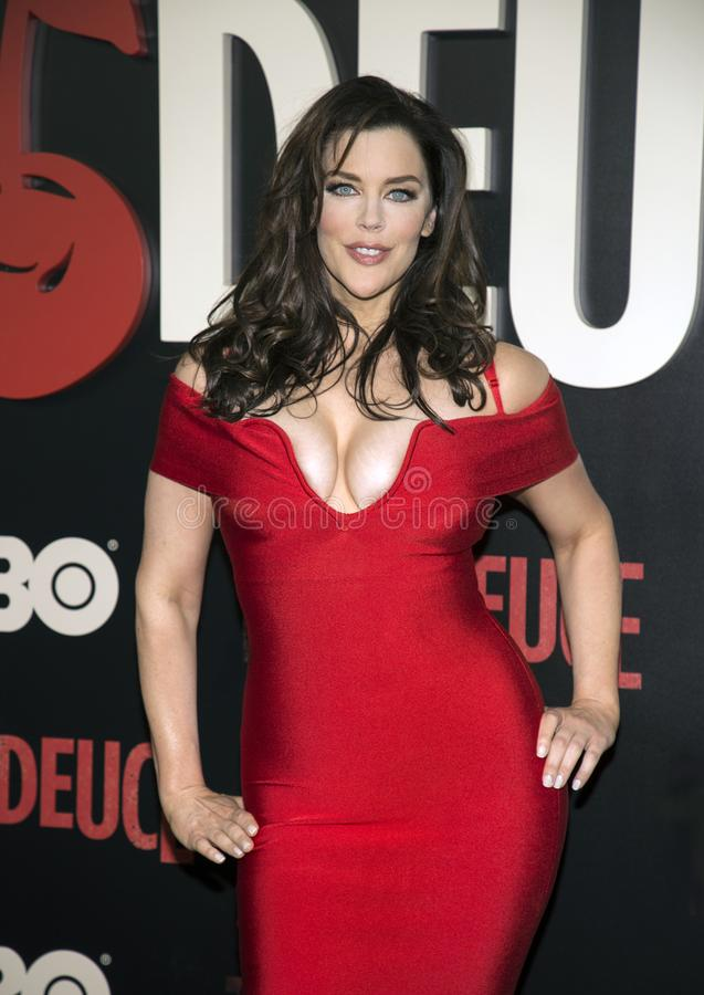 Kim Director. Luscious actress Kim Director arrives on the red carpet for the New York premiere of HBO`s multi-part drama, `The Deuce.` The dramatic series royalty free stock photos