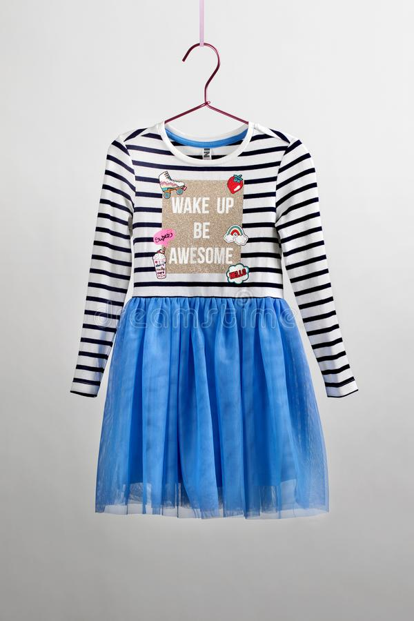 Lush chic skirt with a blouse for girls of tulle. Children's camera, magic wand, accessories stock photo