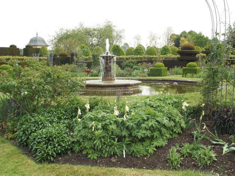 Lush Garden. A Distant Water Fountain stock images