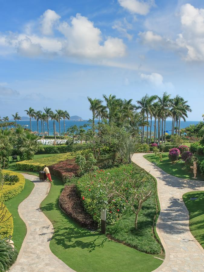 Lush green graden of a Luxury resort along the coastline, Sanya, Island, China. Lush green garden of a Luxury resort along the coastline, Sanya, Hainan Island stock photography