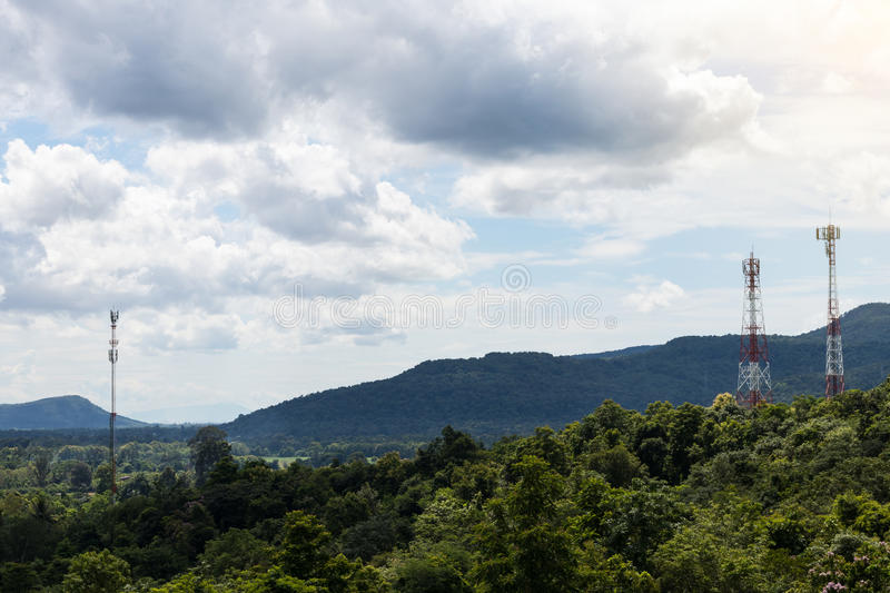 Lush mountains with telecommunication towers. Mountain lush scenery and telecommunication towers with sky clouds are commonly seen in northern Thailand royalty free stock photography