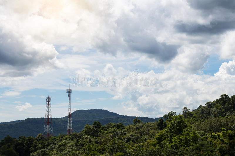 Lush mountains with telecommunication towers. Mountain lush scenery and telecommunication towers with sky clouds are commonly seen in northern Thailand royalty free stock photos