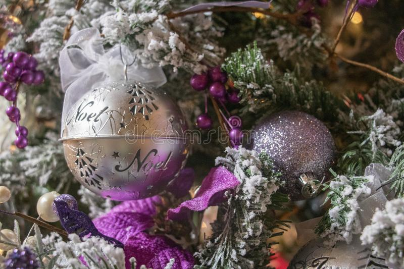 Lush Purple and Silver Decorations on a Frosty Christmas Tree royalty free stock images