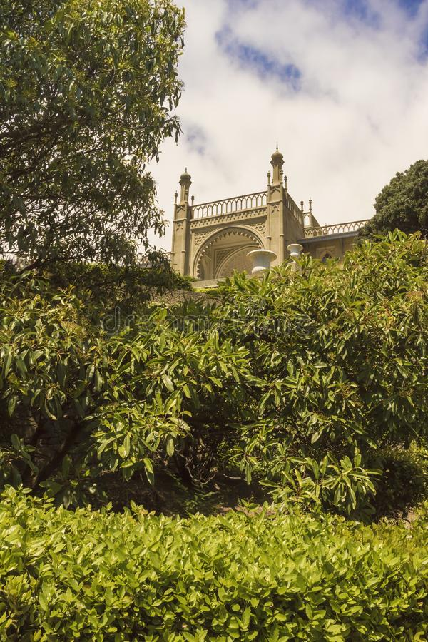 Lush trees and bushes with spring green foliage in the Park at the Vorontsov Palace. Crimea royalty free stock image