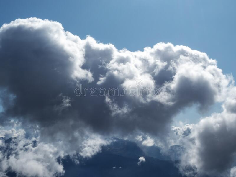 Lush white cloud on a background of a valley and blue sky stock photos