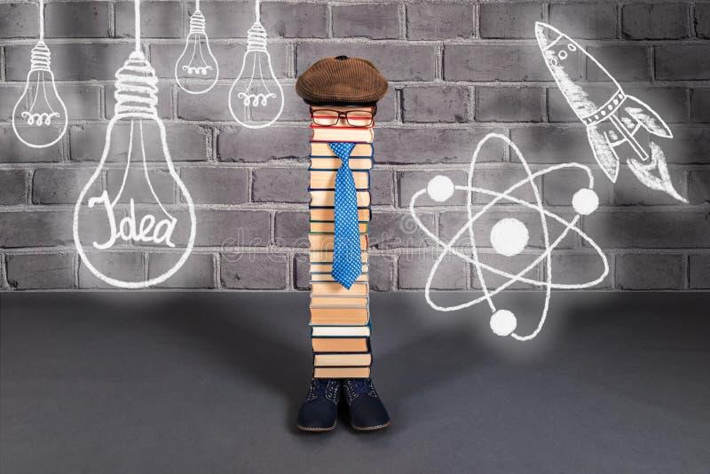 Lustige Bildungsidee, Mannlehrer mit seinen Ideen, Aspirationen stockbild