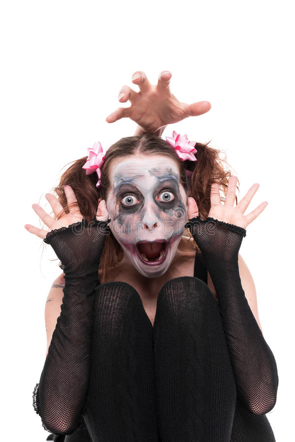 Lustige Frau mit gruseligem Make-up stockfoto