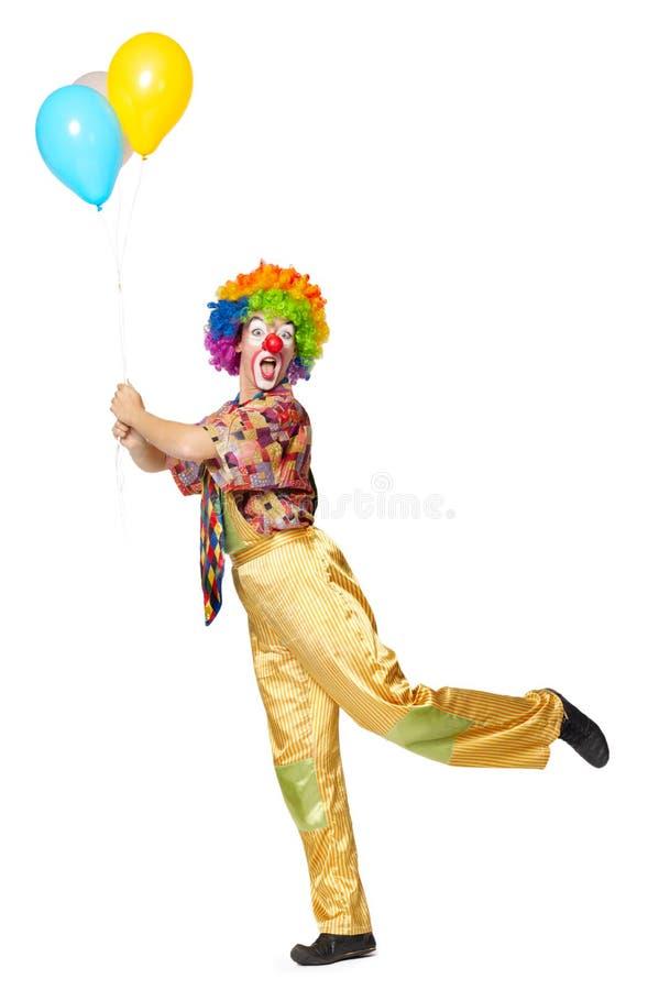 Lustiger Clown mit Ballonen stockbild