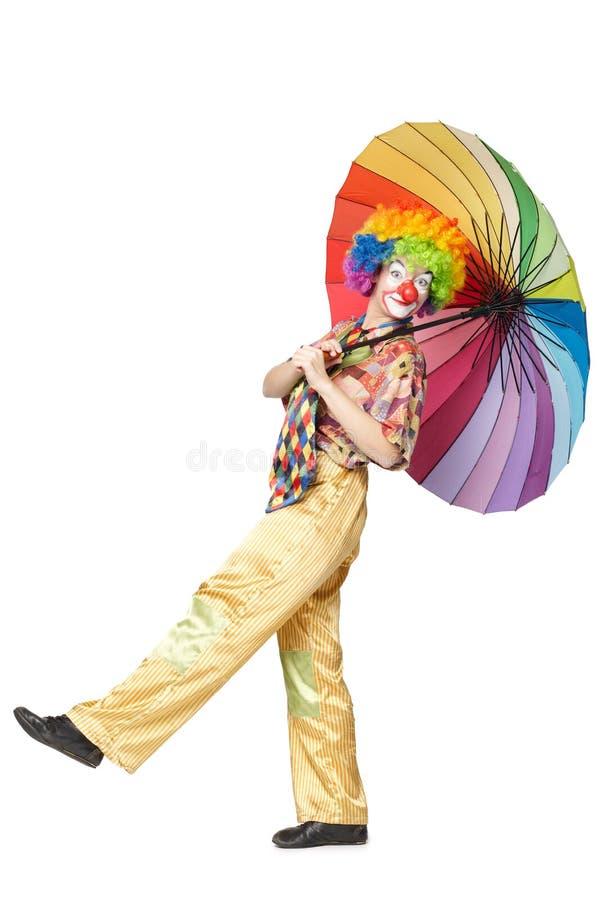 Lustiger Clown mit buntem Regenschirm lizenzfreie stockbilder