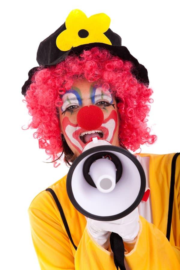 Lustiger Clown mit einem Megaphon stockfotos