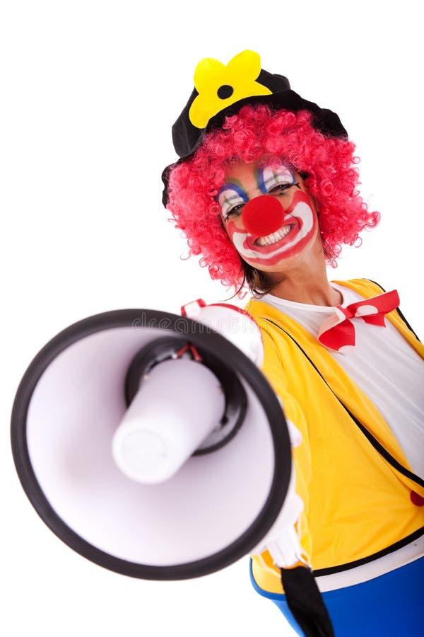Lustiger Clown mit einem Megaphon stockbilder