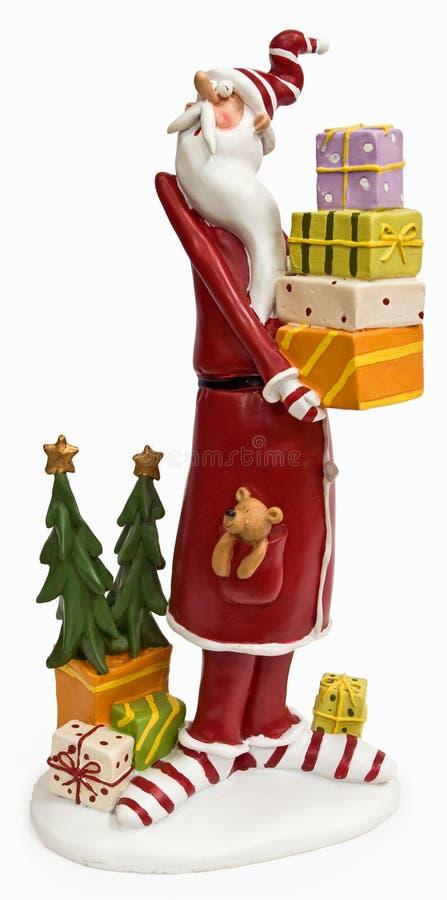 Lustiger hoher dünner Weihnachtsmann im roten Mantel stockbild