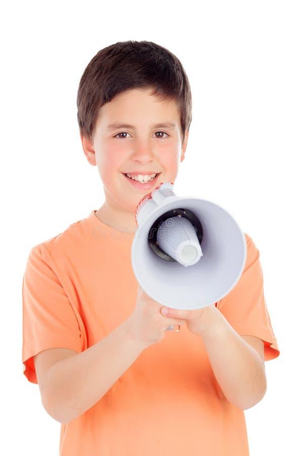 Lustiger Jugendlicher mit einem Megaphon lizenzfreie stockbilder