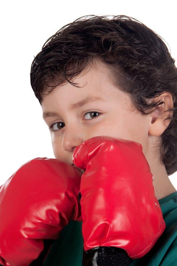 Lustiger Junge mit Verpackenhandschuhen lizenzfreies stockbild