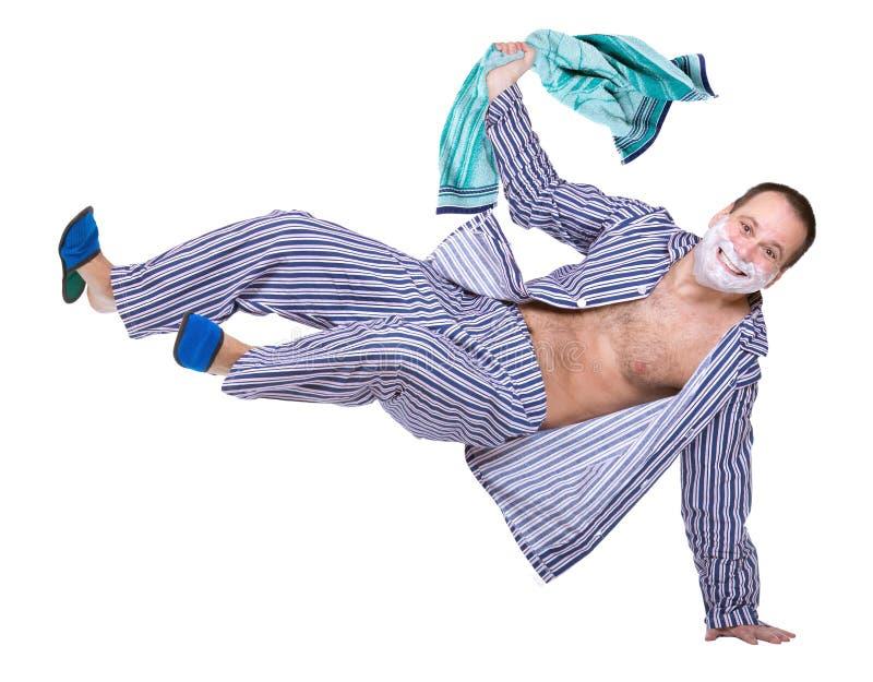 Lustiger netter Mann in den Pyjamas stockfoto
