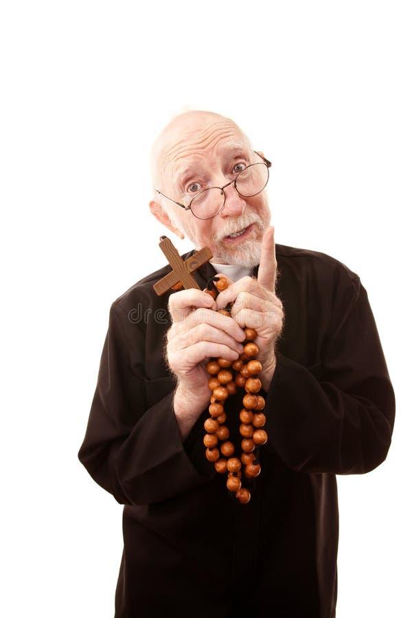 Lustiger Priester stockfotografie