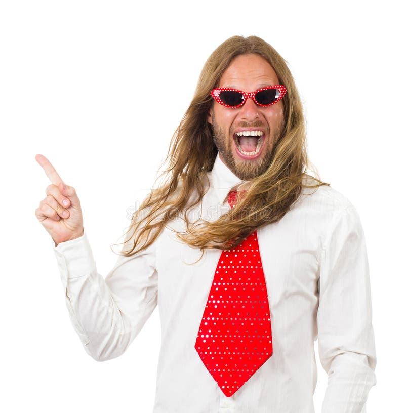 Lustiger Retro- Hippiemann, der auf copyspace zeigt stockfotografie
