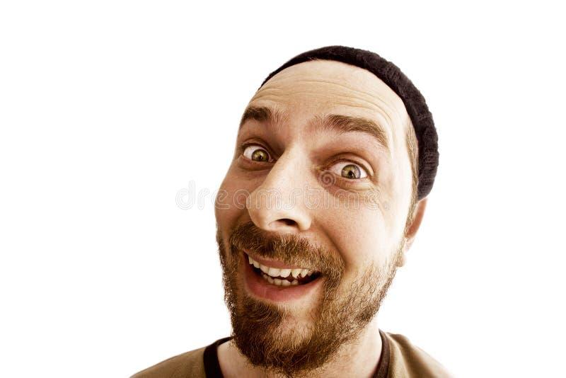 Lustiges Gesicht des frohen sonderbaren Mannes lokalisiert auf Weiß lizenzfreies stockfoto