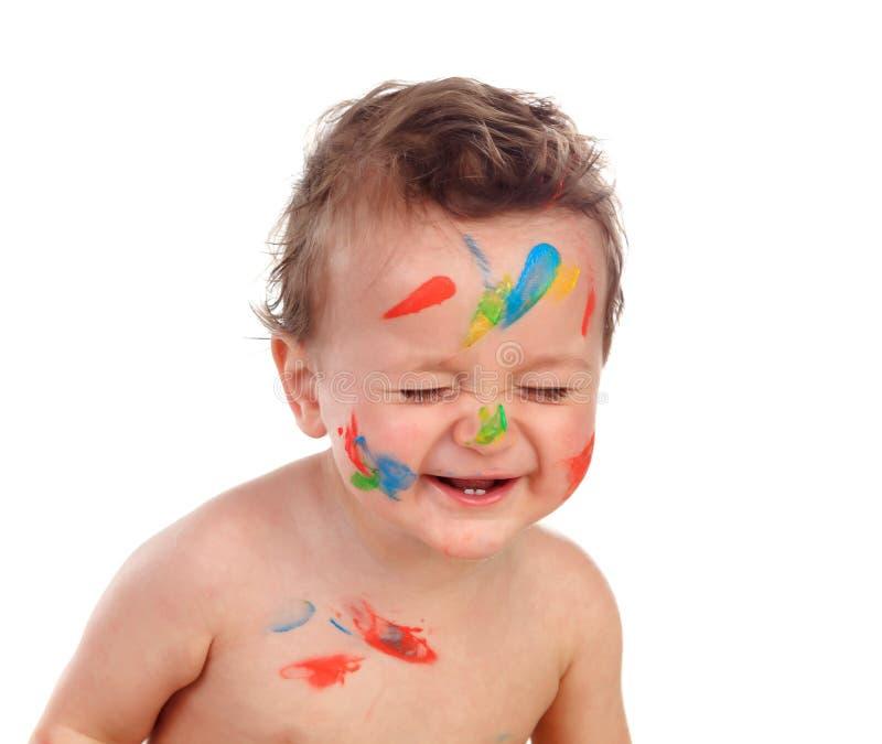 Lustiges Kind schmutzig mit Farbe stockfotos