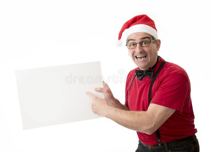 Lustiges 40s zum verrückten Mann der Verkäufe 50s in Santa Christmas-Hut mit BO stockfoto