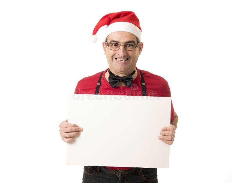 Lustiges 40s zum verrückten Mann der Verkäufe 50s in Santa Christmas-Hut mit BO lizenzfreies stockbild