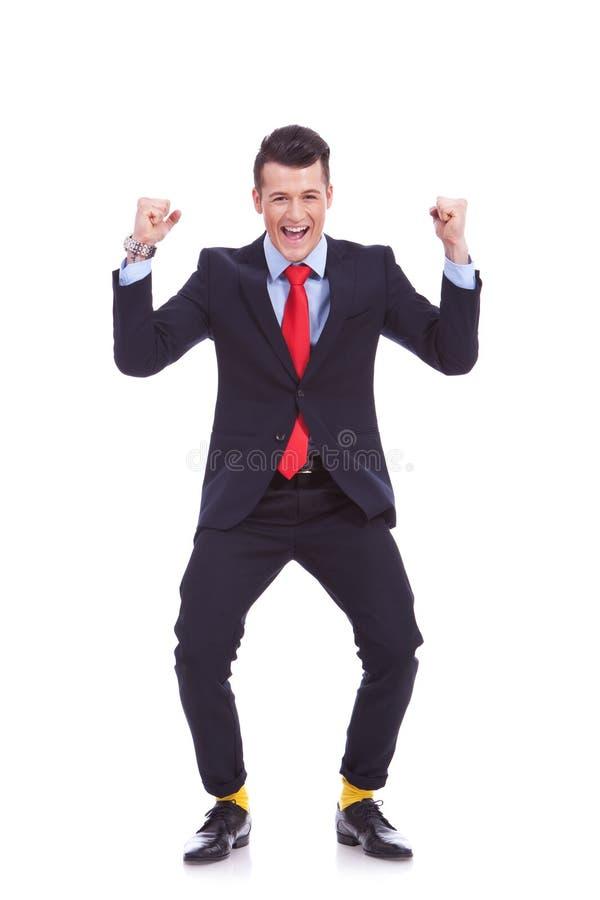 Lustiges schauendes Geschäftsmanngewinnen stockfoto