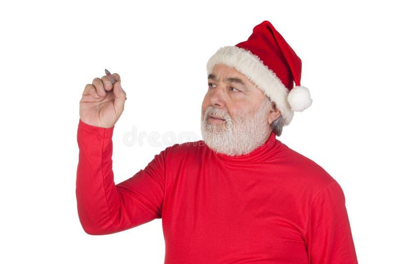Lustiges Weihnachtsmann-Schreiben mit einer Feder lizenzfreies stockfoto