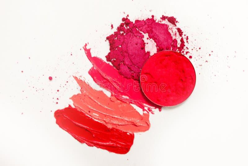 Lustre de la barra de labios y del labio, descensos y movimientos de diversas sombras para crear diversas imágenes en maquillaje fotos de archivo