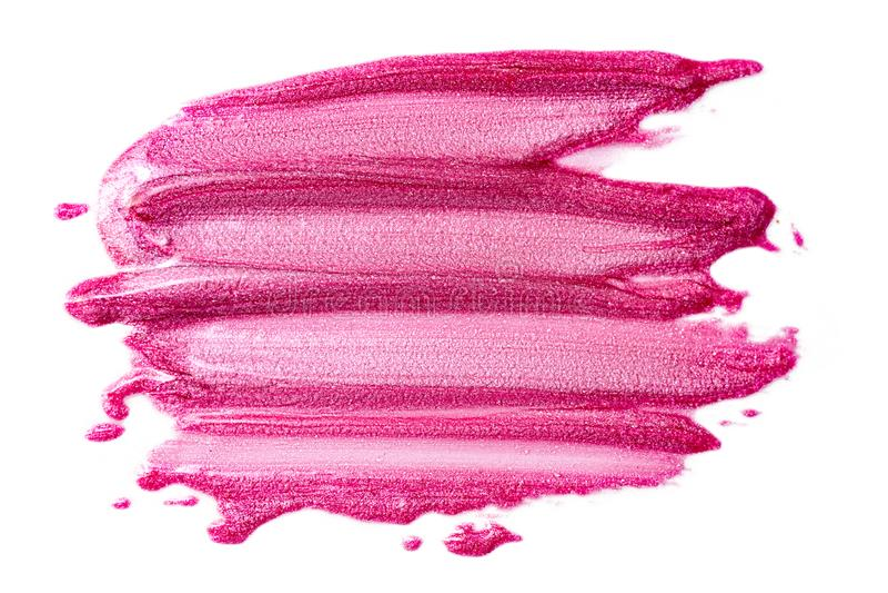 Lustre del labio aislado en blanco Muestra rosada manchada del producto de maquillaje fotos de archivo libres de regalías