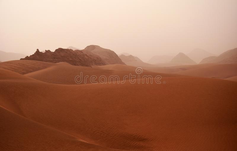 Sand storm in Lut Desert or Dasht-e Lut , Iran. Lut is the world`s 27th-largest desert, and was inscribed on UNESCO`s World Heritage List on July 17, 2016 royalty free stock photos