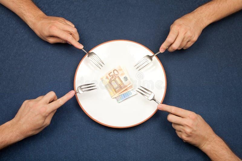 Luta a comer euro foto de stock