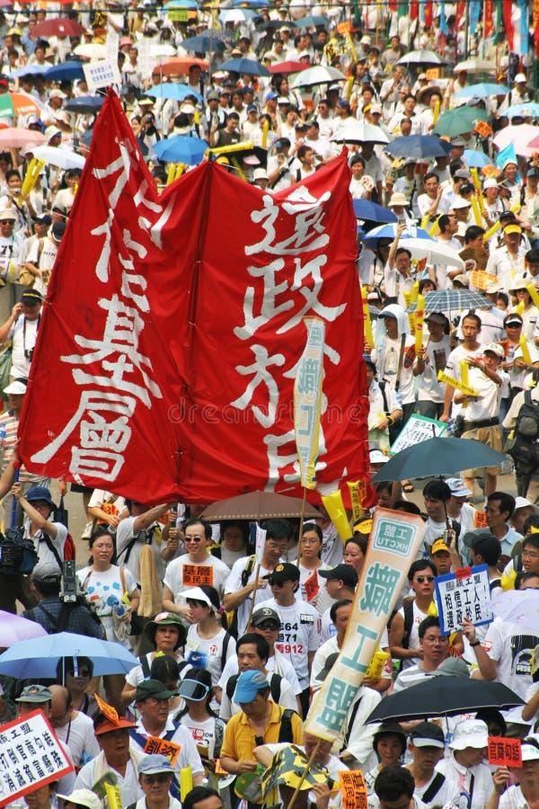 Luta para a democracia. 1 julho 2004 Hong Kong março. imagens de stock royalty free