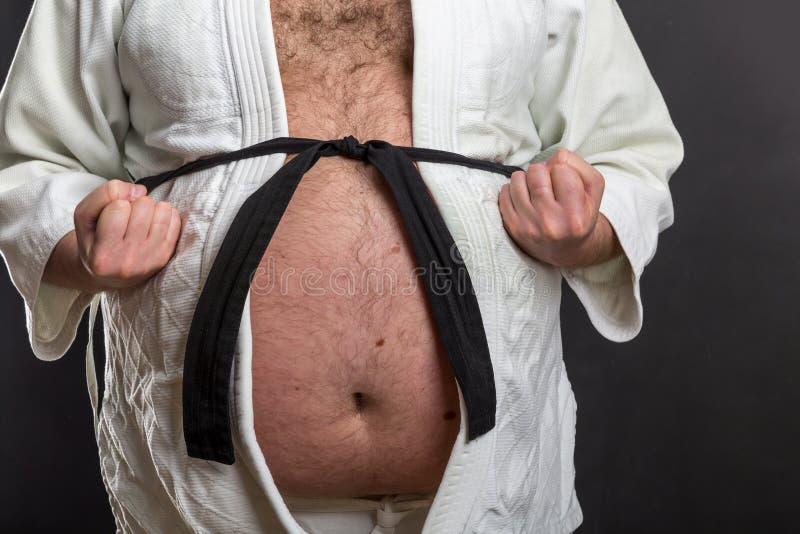 Lutador gordo do karaté fotografia de stock royalty free