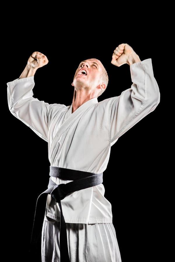 Lutador que levanta após a vitória fotos de stock royalty free