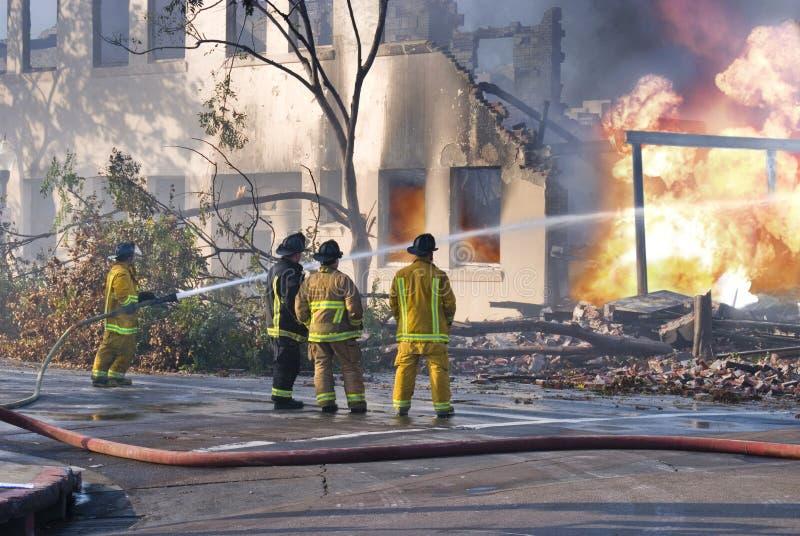 Lutadores de incêndio foto de stock