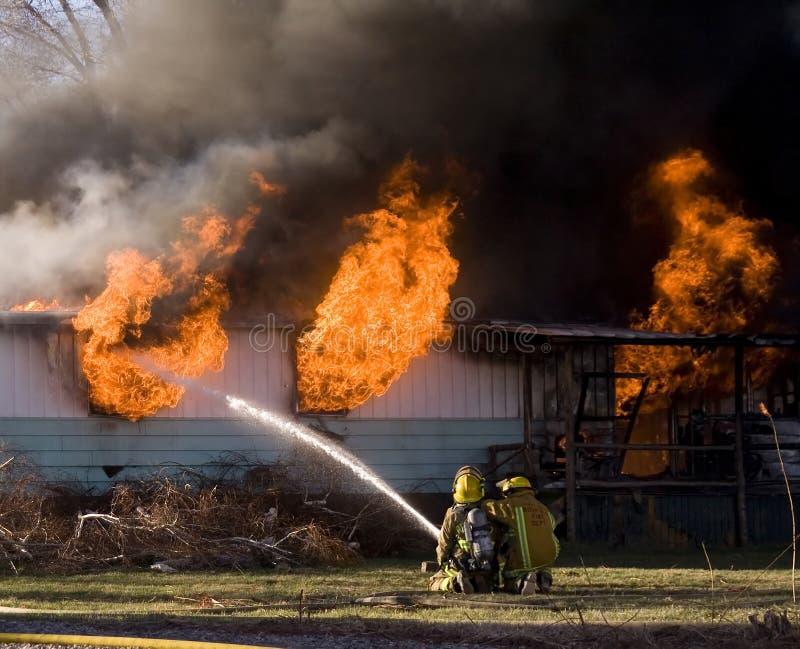 Lutadores de incêndio fotografia de stock