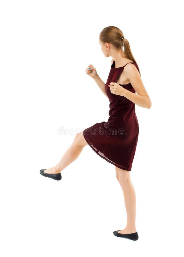 Lutas engraçadas da mulher magro que acenam seus braços e pés foto de stock