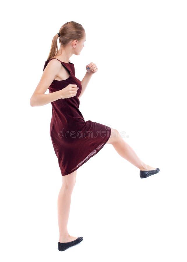 Lutas engraçadas da mulher magro que acenam seus braços e pés fotos de stock royalty free