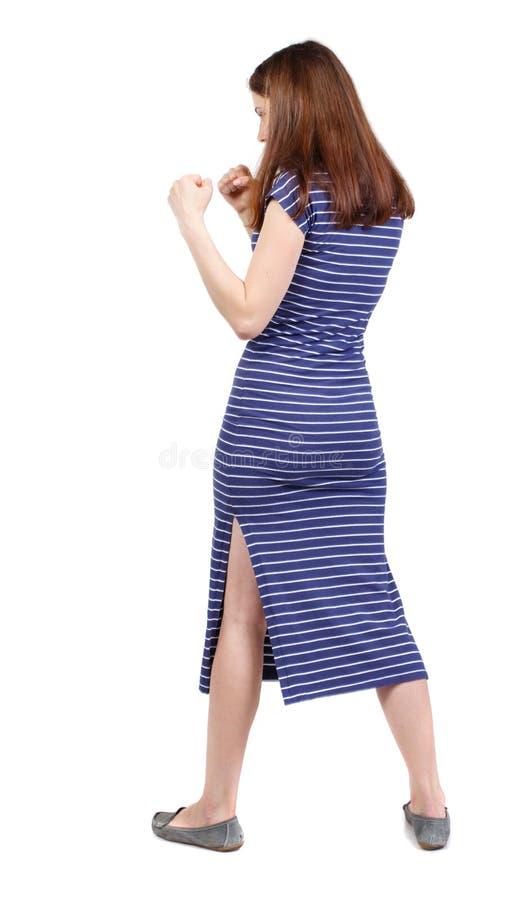 Lutas engraçadas da mulher magro que acenam seus braços e pés imagem de stock royalty free