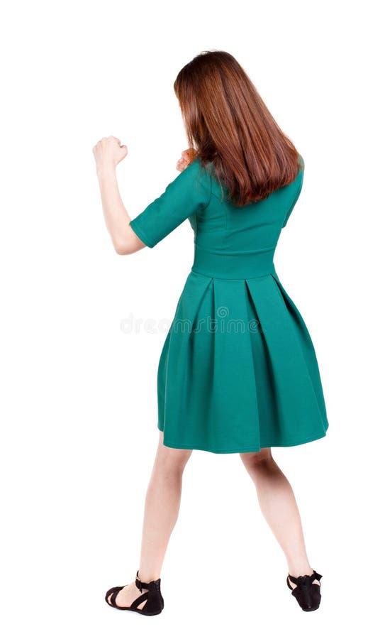 Lutas engraçadas da mulher magro que acenam seus braços e pés fotografia de stock
