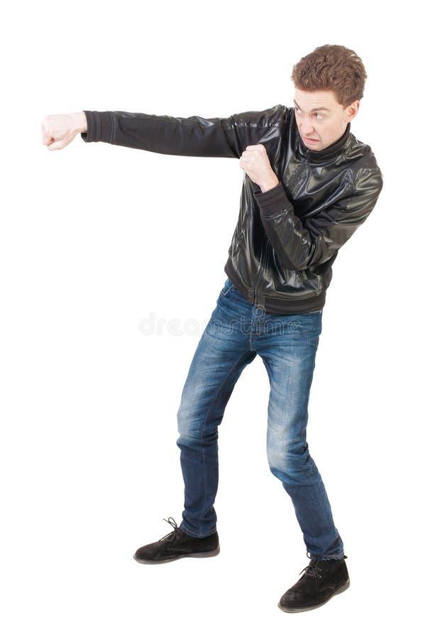 Lutas engraçadas do indivíduo magro que acenam seus braços e pés fotos de stock