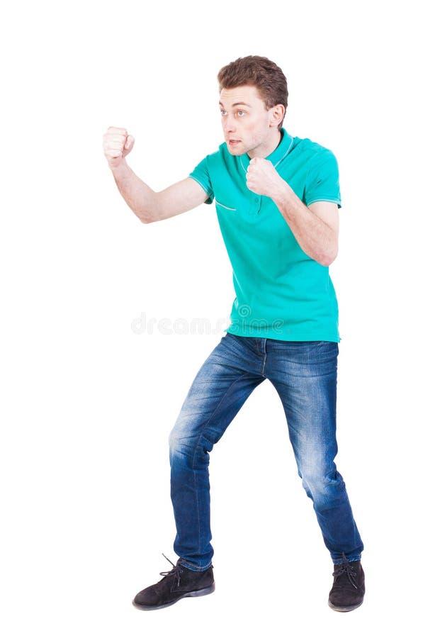 Lutas engraçadas do indivíduo magro que acenam seus braços e pés imagens de stock