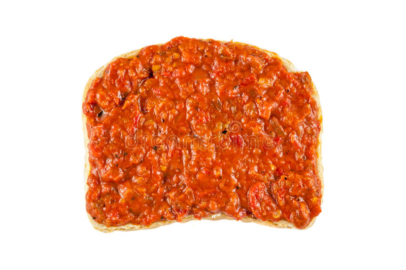 Lutenica - Bulgarian relish. Traditional Bulgarian relish called Lutenica. Spread on a slice of white bread stock images
