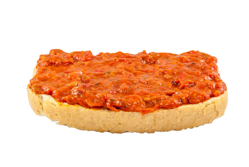 Lutenica - Bulgarian relish. Traditional Bulgarian relish called Lutenica. Spread on a slice of white bread stock photos