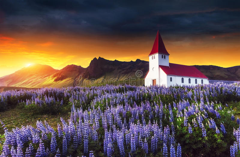 Lutheran church in Vik. Fantastic sunset. Iceland stock photography