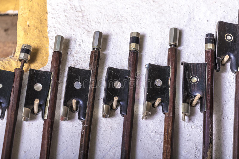 Luthier. Bows from a luthier workshop royalty free stock photos