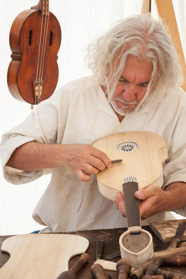 The luthier builds a medieval stringed instrument royalty free stock photos