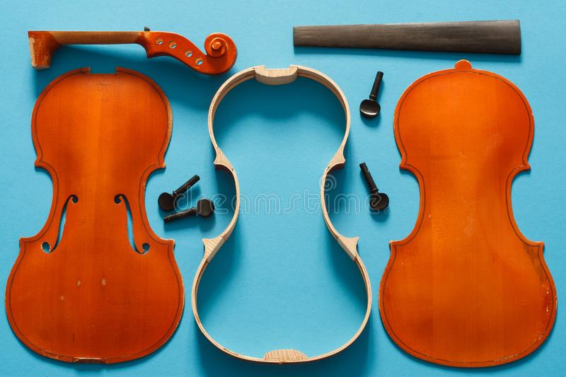 Luthier violin disassembled and all parts in order stock photography