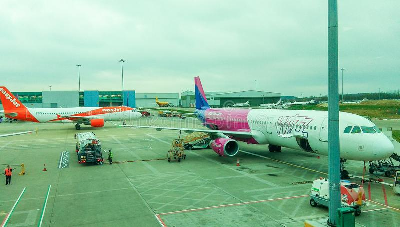 Luton, United Kingdom - 03/20/2019 - view on Wizzair luggage boarding. And easyjet in distance royalty free stock image